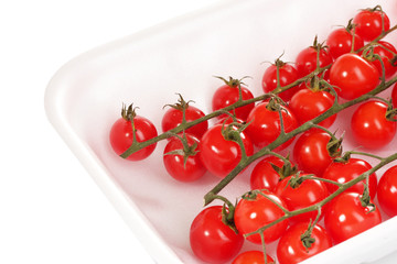 cherry tomatoes in packaging isolated on white