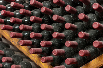 Stack of Aging Red Wine Bottles