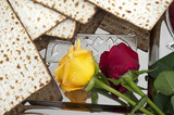 Matza bread for passover celebration and roses