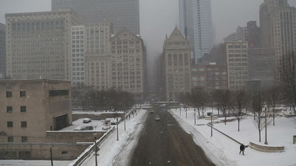 View of traffic and snow in Chicago on foggy day, video