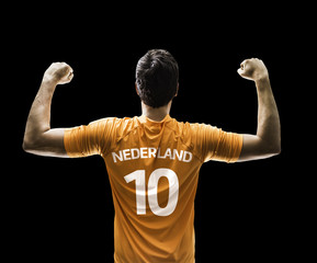 Dutch soccer player celebrates on black background