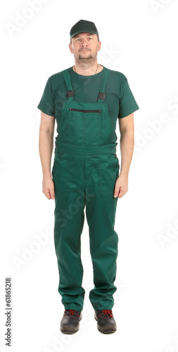 Worker in green overalls. Front