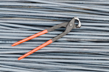 Iron cutting tongs on steel rod