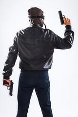 Dangerous man holding guns
