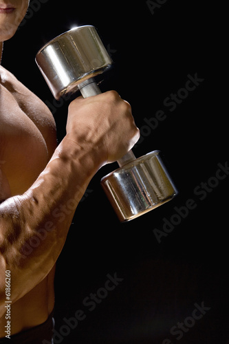 an arm with dumbbell