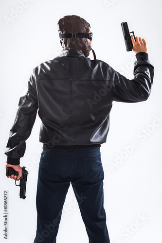Dangerous man holding guns