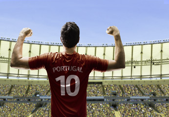 Portuguese soccer player celebrates on the stadium with the fans