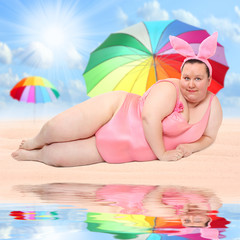 Overweight woman relaxing on a tropical beach.