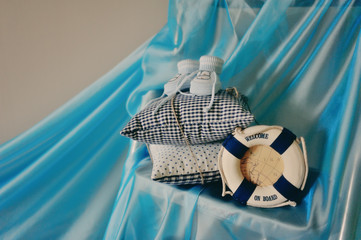 Maritime composition on a blue background pillows, baby booties