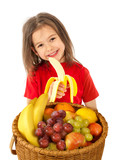 Happy little girl with basket of fruits