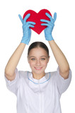 Female doctor held up a heart symbol