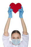 Nurse in  mask held up a heart symbol