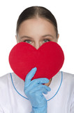 Doctor peeking out from behind a heart symbol