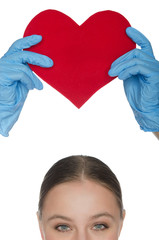 Woman held up a heart symbol