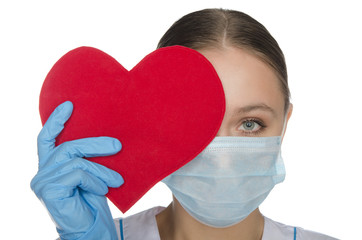 Doctor in a mask covering her eyes heart symbol