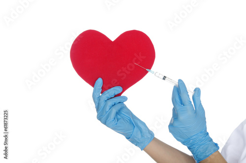 Hand with medical glove makes shot in the heart