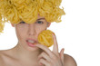 Nude young woman with curls of pasta