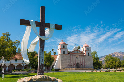 Mission Santa Barbara with cross and sky blue background