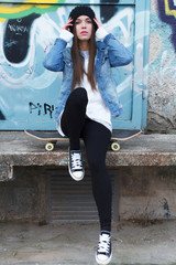 Urban girl with skateboard