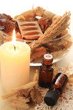 dried plant and candle with essential oil