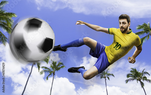 Brazilian soccer kicks the ball on many palm trees