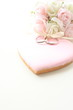 pink icing cookie with wedding rings