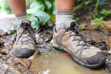 Hiking shoes on hiker in water puddle