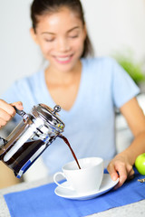 Coffee - woman drinking french press coffee