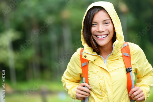 Rain woman hiking happy in forest