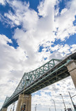 Steel bridge on blue sky with some clouds