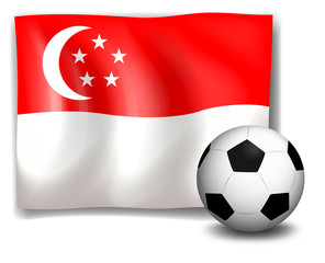 A soccer ball in front of the flag of Singapore