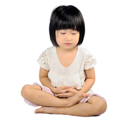 asian small child doing meditation in buddhism practice