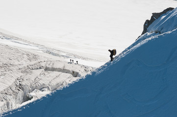 Alpinists walking on glacier in the mountain.