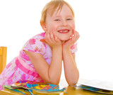 Smiling girl reading the book