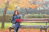 Student learns outdoor - student using laptop