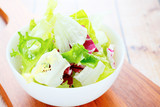 lettuce for salad in a white bowl