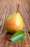 Pear with green leaf