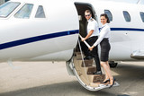Stewardess And Pilot Boarding Private Jet