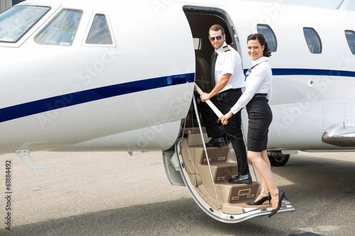 Stewardess And Pilot Boarding Private Jet - 61884492