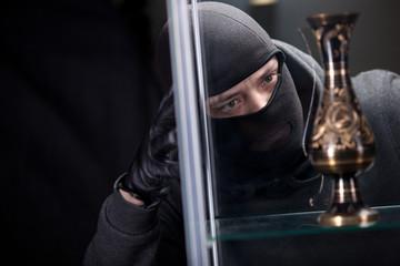 burglar wearing black mask