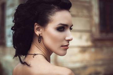 Beautiful fashion brunette woman creative hairstyle street portr
