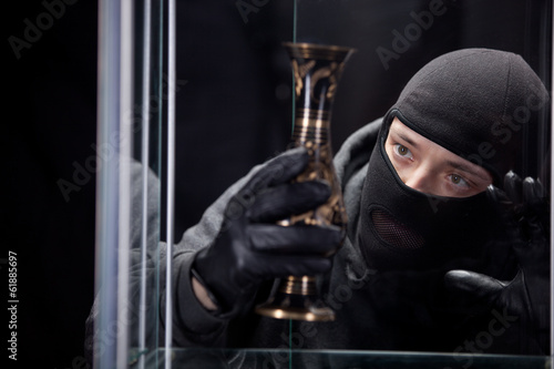 burglar wearing black mask
