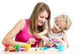 kid and mother play colorful clay toy