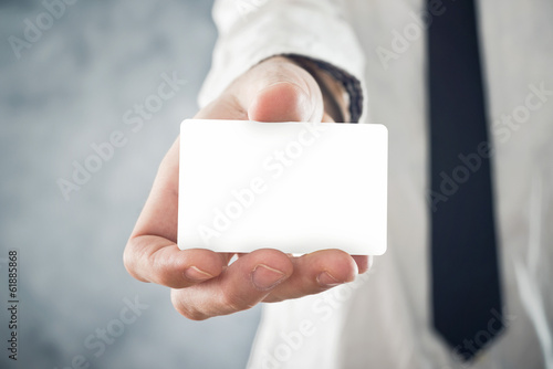 Businessman holding blank visiting card with rounded corners