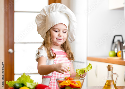 cute girl preparing healthy food vegetable salad