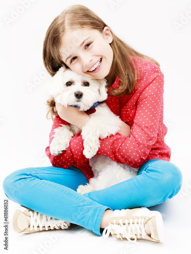 Young girl with  puppy, cute Maltese dog