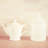 Classic porcelain teapot and jar with retro filter effect