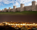 A view of city of Avila during day and night