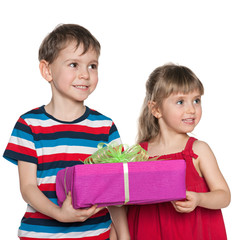 Two children hold a gift box
