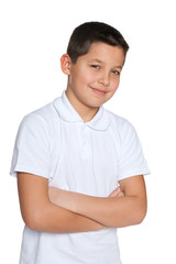 Confident young boy in white shirt